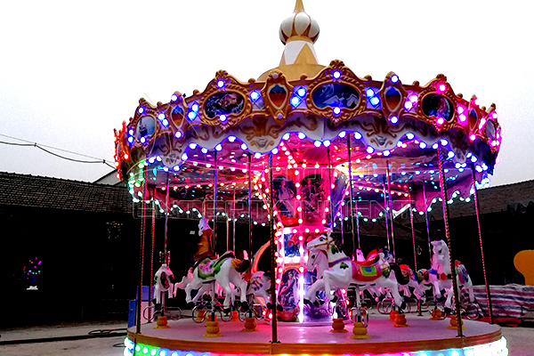 The Beautiful Carousel Rides with Colorful Lights at Night are Favored by Kids and Young People