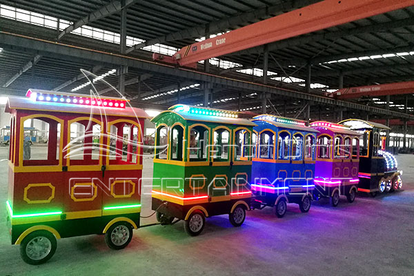 Dinis Cartoon Vintage Carnival Train Rides for Sale with Colorful Lights at Night