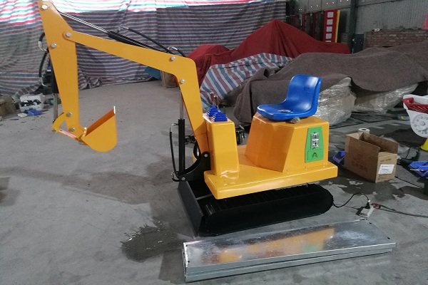 Small Amusement Park Excavator Ride for Sale Displayed in Dinis's Exhibition Hall